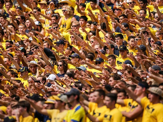 Michigan's fans cheer during their home opener game