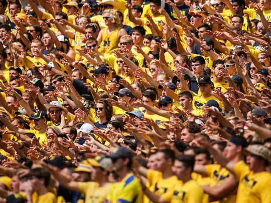 Michigan's fans cheer during their home opener game against Hawaii at Michigan Stadium in Ann Arbor in September 2016.