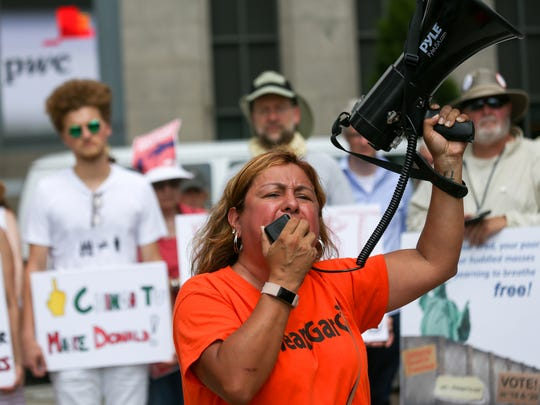 Cindy Garcia talks about her family's struggle since her husband was deported. She and hundreds more gathered to protest President Donald Trump's zero tolerance immigration policy during the Families Belong Together rally in downtown Detroit on Saturday, June 30, 2018.