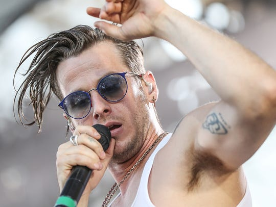 Foster the People lead singer Mark Foster performs