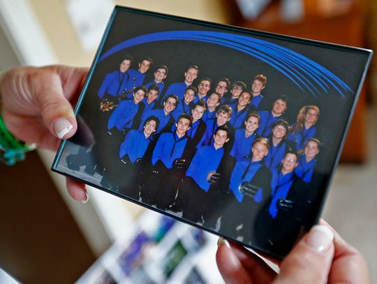 Marilyn McCalley shows a photo of the 2016 Carmel High