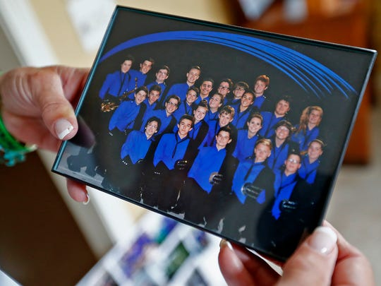 "Marilyn McCalley shows a photo of the 2016 Carmel High School Marching Band, in her Carmel home, Tuesday, July 2, 2018.  Her late son, Patrick McCalley, was in Carmel High School Marching Band.  This photo added Patrick's photo in the middle of  group.  On Oct. 6, 2016, their son, Patrick McCalley, a Carmel High School junior, was called to the assistant principal's office over a ""racially insensitive"" Snapchat he sent to a few friends. The honors student signed an affidavit and was told he'd be suspended. Before 3:36 p.m., about half an hour after being escorted out of the school, Patrick attempted suicide. He died in the hospital at 5:07 p.m."
