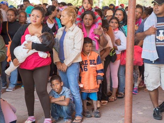 Central American migrants gathered outside a church