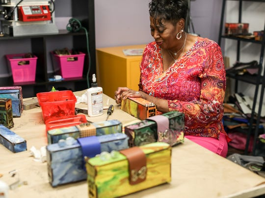 Brenda Wyatt, 65, of Oak Park puts together a clutch for Bags to Butterflies at a studio in Detroit on Tuesday,  June 26, 2018.