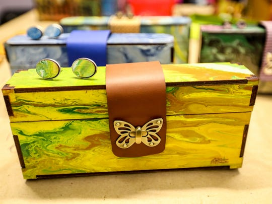 A clutch and matching cuff links sold by Bags to Butterflies.