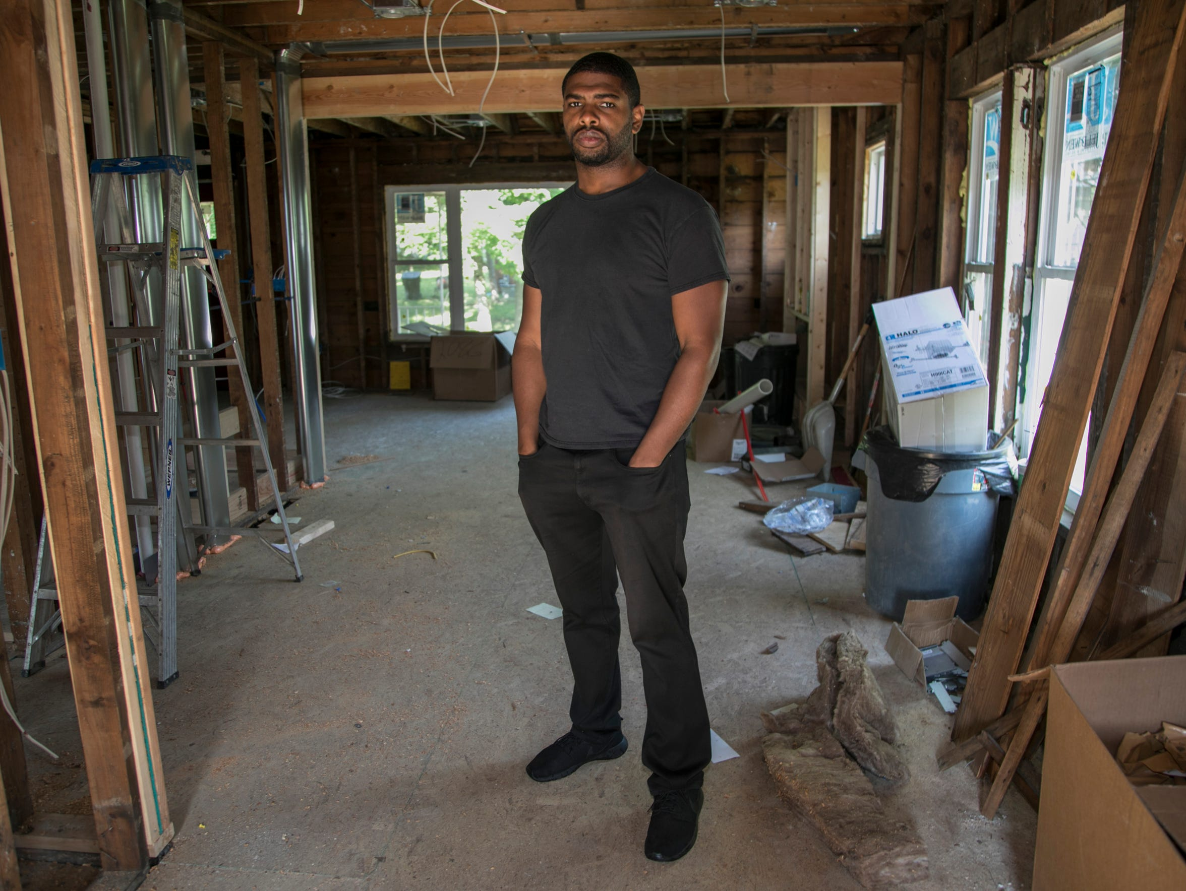 Gaston Nash, 35, on a June day stands in the Monica Street home he is currently rehabbing in the Fitzgerald neighborhood in Detroit. Nash, who lives next door and is president of the College Core Block Club, said the revitalization project is progressing slower than city leaders promised.