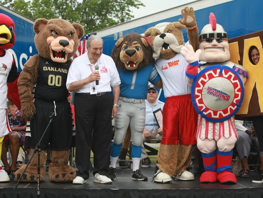 Ed Deeb is joined by mascots from local universities