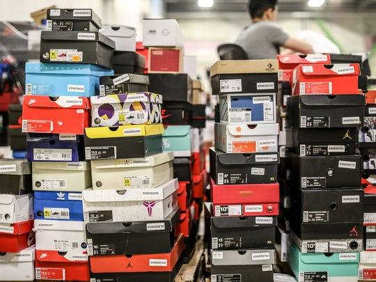 Sneakers are stacked up in the inventory area of the