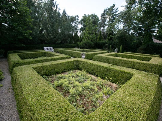 More than 600 boxwood shrubs are trimmed into the eight