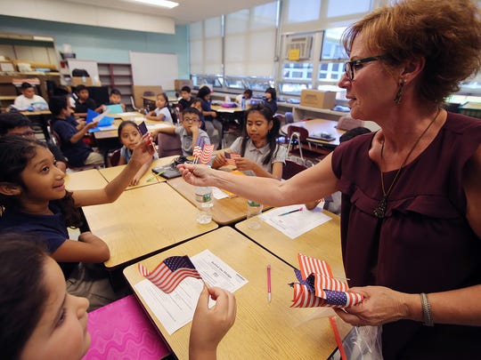 Wendy Buchanan hands out American flags to her third grade students during her lesson at the Park Avenue School in Freehold, NJ Thursday June 14, 2018.
