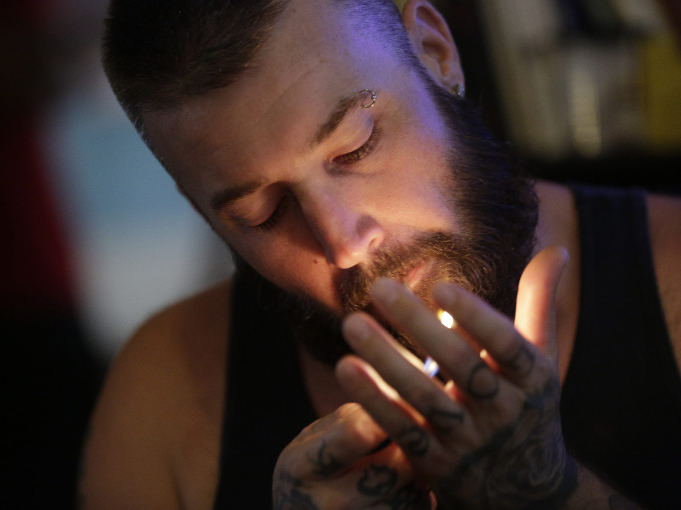 Ryan, 38 of Phoenix Ariz., who is on his honeymoon, lights up during 4:20 Happy Hour at the Adagio Bud and Breakfast.