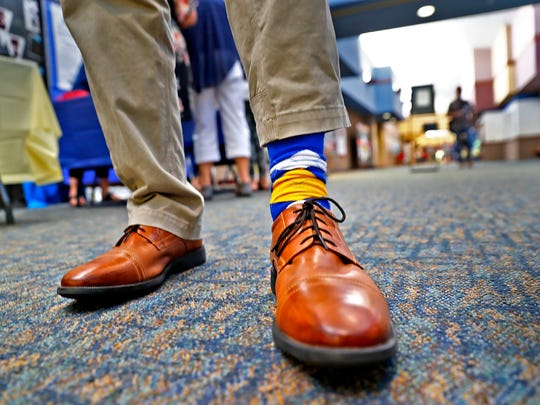 New Superintendent of Carmel Clay Schools Michael Beresford wears Carmel schools colored socks while attending the #C4: Connect, Collect, Collaborate, and Create conference, held at Clay Middle School, Wednesday, July 11, 2018.