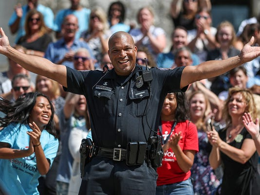 """IMPD films lip sync battle to """"Can't Stop the Feeling!"""" by Justin Timberlake on Monument Circle, Thursday, July 12, 2018"""