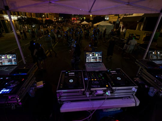 People dance at the silent disco on Boat Night Friday,