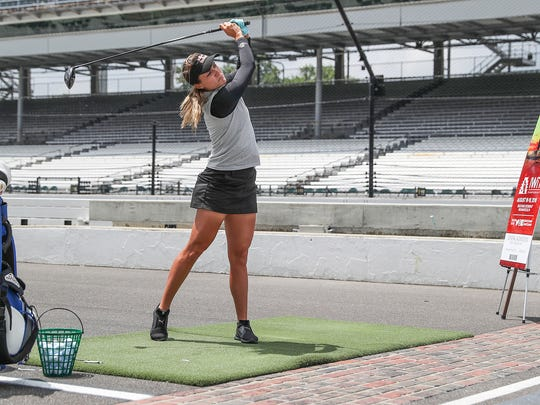 Lexi Thompson watches her drive as it leaves the Yard of Bricks at Indianapolis Motor Speedway, where she helped unveil the ticket for next month's LPGA Indy Women in Tech Championship at Brickyard Crossing Golf Course in Indianapolis, Monday, July 16, 2018.