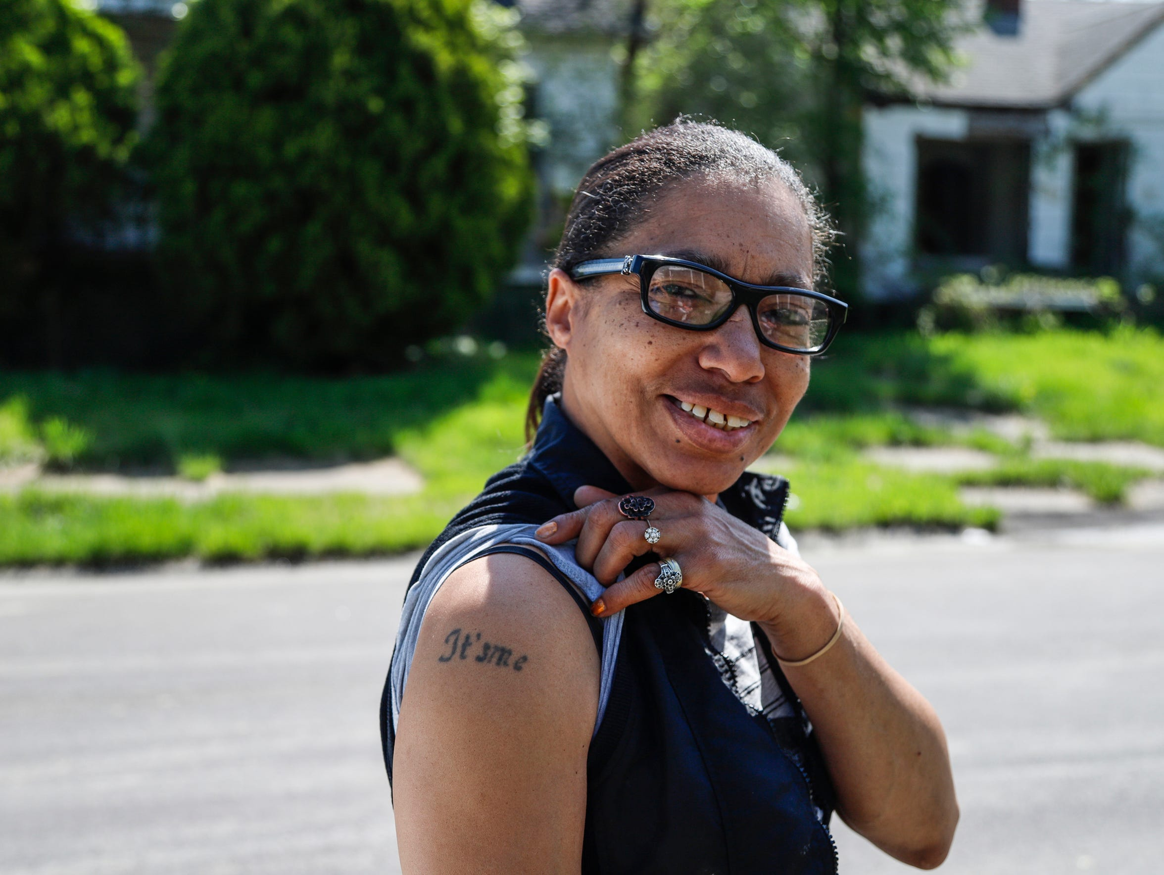Alpine Street resident Aquin Hill in May shows off a tattoo of her nickname on her right arm. (Photo taken May 17, 2018)