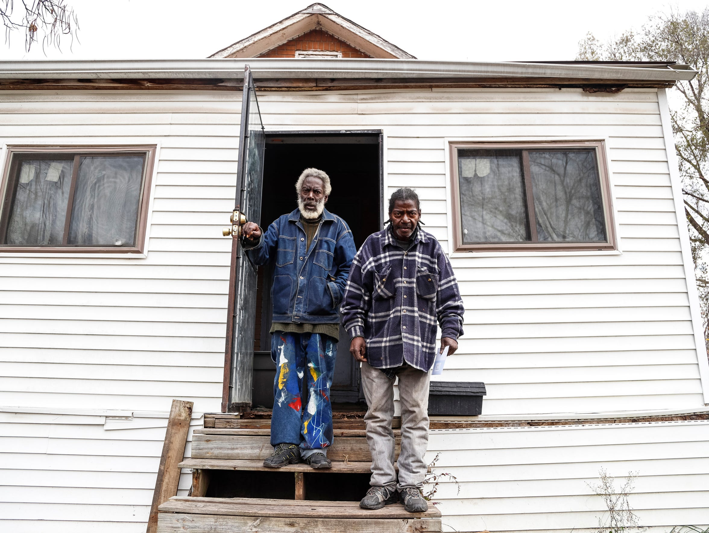 Twins Wardell and Ordell Belt pose in November outside their home on Alpine Street in Detroit. (Photo taken Nov. 22, 2017)