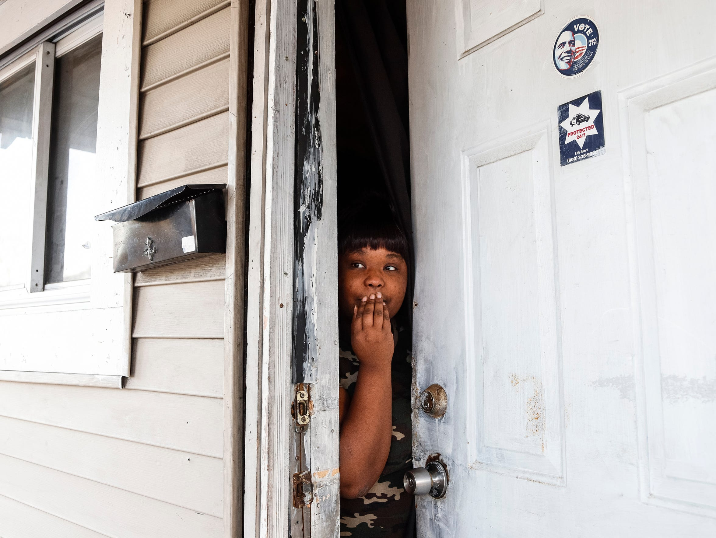 Pauletta Lawrence talks to the Free Press in December from the door of a land bank house on Richton where Immanuel Foster, 7, was found tortured in 2014. The boy died. (Photo taken Dec. 20, 2017)