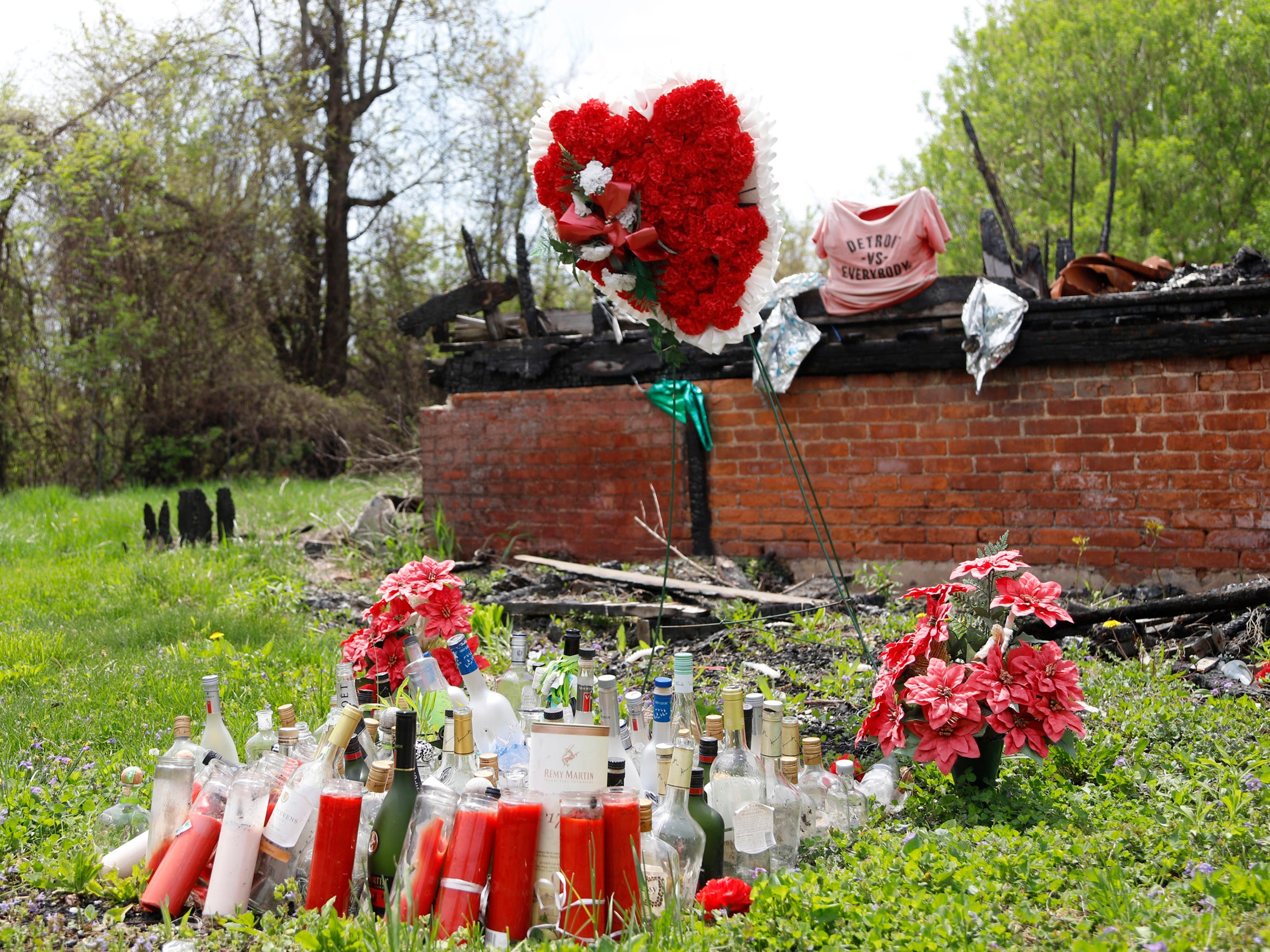 A shrine outside of 5797 Garland Street, where Jevonta Malone, 26, was shot and killed in July 2016. (Photo taken May 9, 2018)