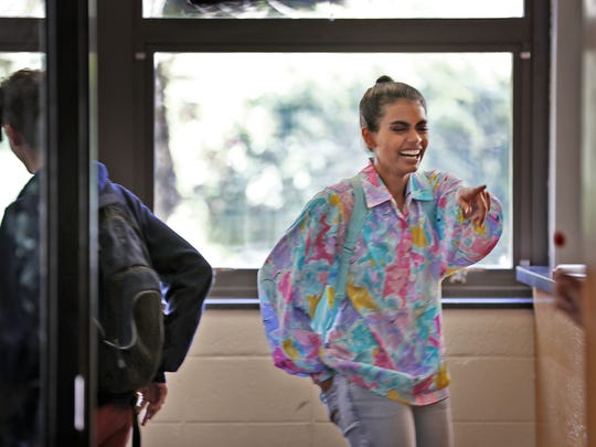 """Megan Suri, playing the lead character Bindu, laughs between scenes on the filming set of the Duplass Bros. movie, """"The Miseducation of Bindu,"""" Tuesday, July 17, 2018, at the old Broad Ripple High School."""