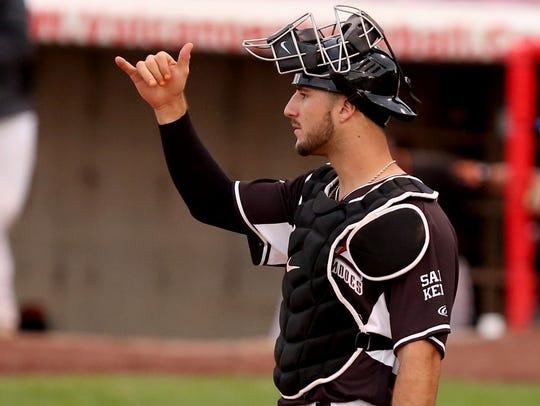 Volcanoes catcher Joey Bart (46) signals to his pitcher