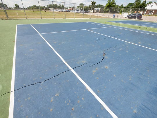 Cracks on the tennis courts at Marysville High School