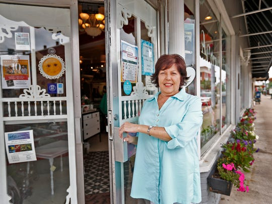 Peggy Kumler stands in front of her Noblesville business,