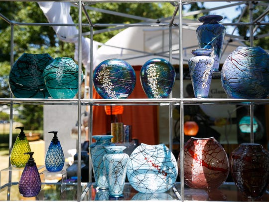 Glass art created by Bryce Dimitruk on display at the Salem Art Fair on Friday, July 20, 2018, in Bush's Pasture Park. Dimitruck and his wife Miyuki acquired Vines Art Glass in 2004 and have been creating a product line under that name since.