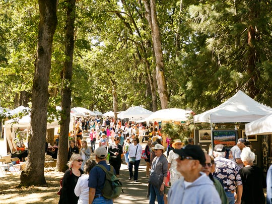 Crowds at the Salem Art Fair on Friday, July 20, 2018,