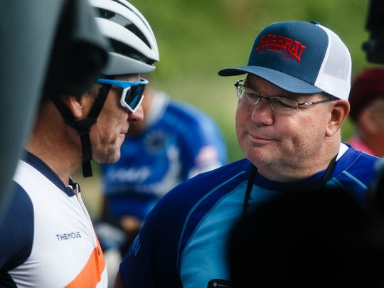 Lance Armstrong talks with then-RAGBRAI director T.J. Juskiewicz during a stop on the second day of the 2018 Register's Great Bicycle Ride Across Iowa.