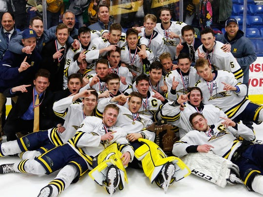 Hartland celebrates winning the 2018 state Division 2 hockey championship.