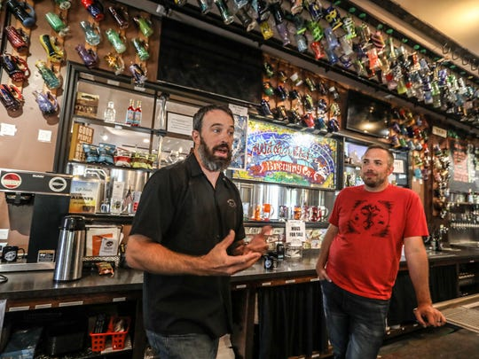 Ryan Cottongim, left, is the owner of the Witch's Hat