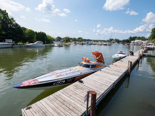 Crews work to prepare their boats for the Offshore Powerboat races Sunday, July 29, 2018 in St. Clair.