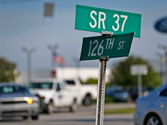 Vehicles travel on IN State Road 37 and 126th St.,