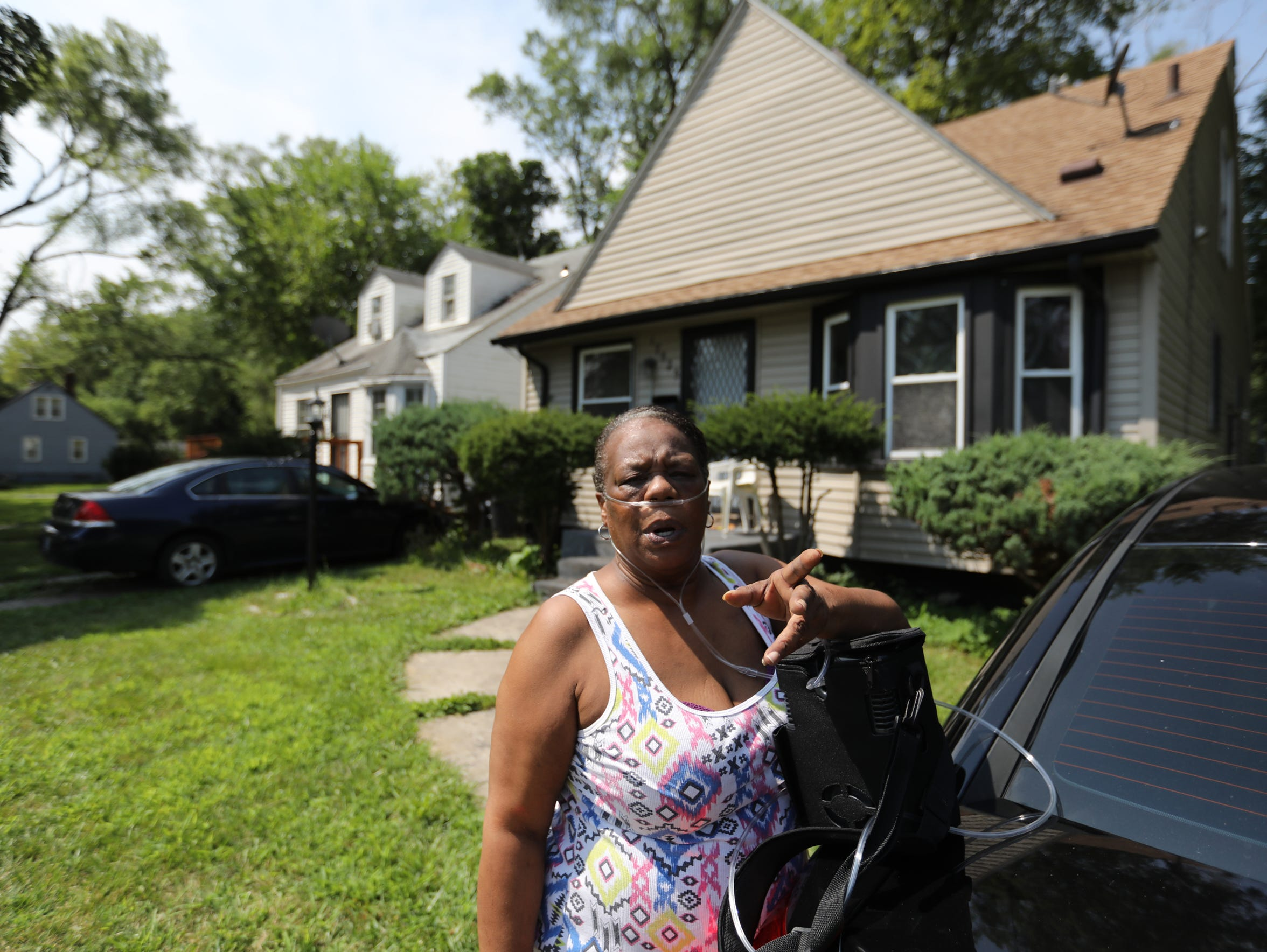 Felicia Anderson, 60, in front of her home on Heyden