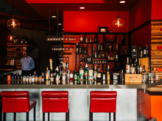 The bar inside Tannin Okemos is quaint, but well stocked, with liquor old and new.