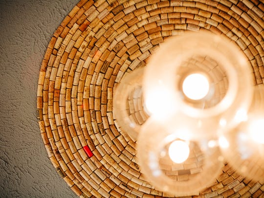 The lights inside Tannin are accented with wine corks collected over the years.