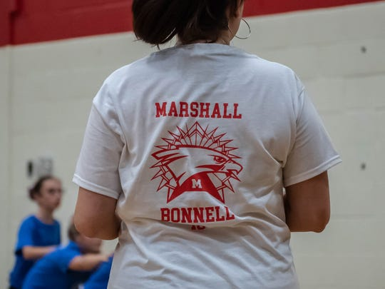 The Marshall and Harper Creek volleyball teams joined together to wear special shirts for a middle school volleyball match in support of Trish Albrecht, the mother of one of their players and aunt to another, who died last week after being hit by a car.