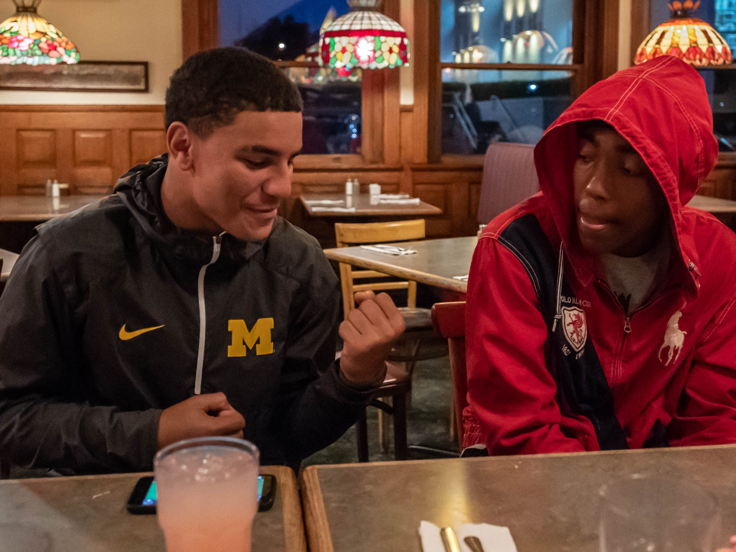 """Markel Main, left, and Theo Shepherd play football for Battle Creek Central. They were at Clara's on the River Tuesday night for """"Tuesdays with Coach Bess."""""""