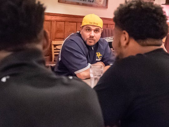 Casey Bess is an assistant football coach for Battle Creek Central. He's organized a weekly dinner for players at Clara's on the River.