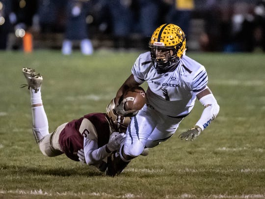 Battle Creek Central's Joshua Mann (1) advances the ball during first half action against Parma Western Friday evening.