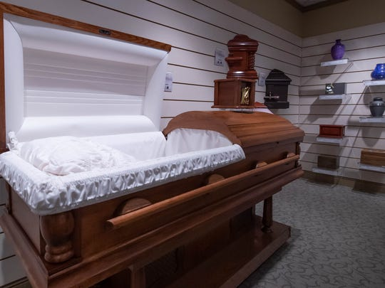 A sample of a cremation casket on display in their presentation room at Kempf Family Funeral and Cremation Services in Battle Creek.