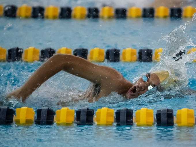 Battle Creek Central's Brandon Cole competes in the