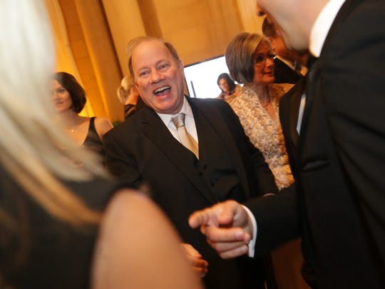 Detroit Mayor Mike Duggan greets people during A Night of Illusion: The DIA Gala Extravaganza, a benefit dinner at the Detroit Institute of Arts in Detroit on Saturday, Nov. 8, 2014.