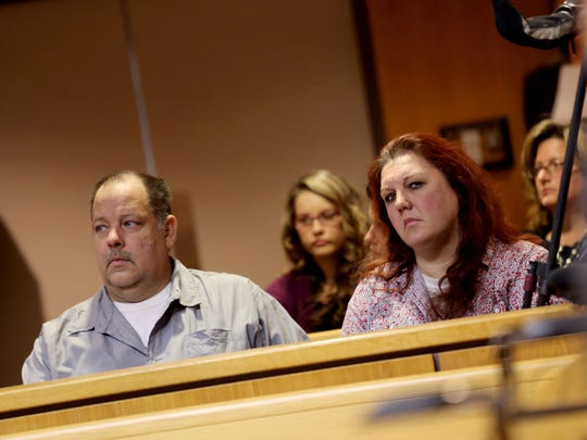 April Millsap's stepfather, David Lichtenfelt, and her mother, Jennifer Millsap, listen in the courtroom as James D. VanCallis was arraigned and held without bond in the murder on July 24, 2014 of their daughter April Millsap, 14, of Armada on Thursday, October 9, 2014 at the 42-1 District court in Macomb County.