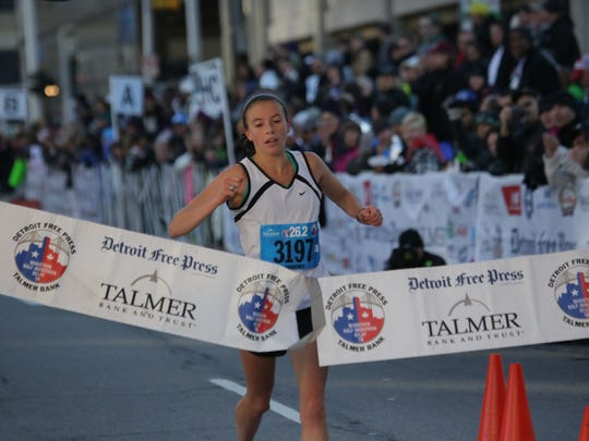 Courtney Brewis wins the Women's Full marathon for the 37th Annual Detroit Free Press/Talmer Bank Marathon on Fort Street in Detroit on Sunday, Oct. 19, 2014.