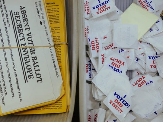 Stickers and absentee voter ballot secrecy envelopes.