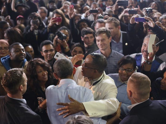 President Barack Obama greets supporters after speaking at Wayne State University.