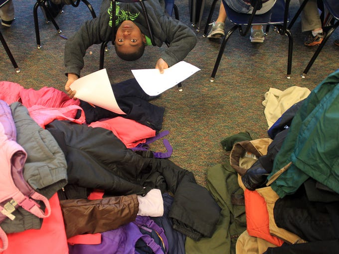 Longfellow Elementary 4th grader Keneal Tate stretches