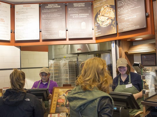 Guests order lunch at the new Panera in Coralville